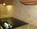 simple diagonal tile kitchen backsplash