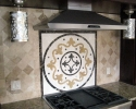 Backsplash in travertine and using a medalion